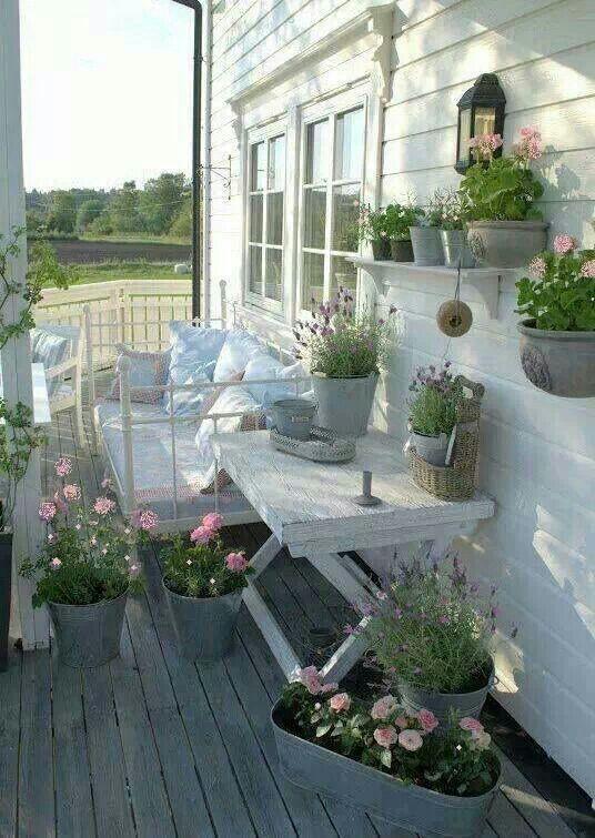 veranda-fiori-rosa-vasi