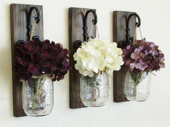 barattoli fiori muro